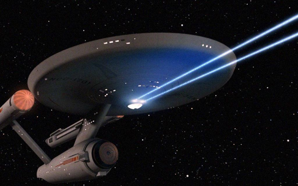 The Enterprise fires phasers in the original Star Trek series.