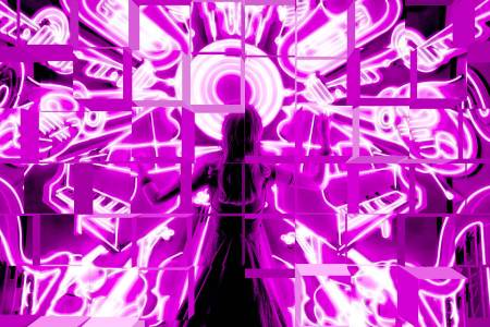 Fractured image of woman facing neon signs of musical instruments